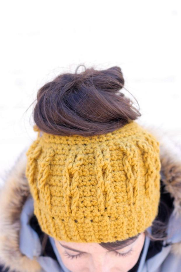 FREE Pattern  This Stylish Crochet Messy Bun Beanie with Faux Cables Is  Fast and Easy! e0df333ed336